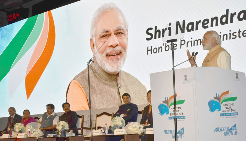 Prime Minister, Shri Narendra Modi addressing at the Maritime India Summit, in Mumbai on April 14, 2016. The Governor of Maharashtra, Shri C. Vidyasagar Rao, the Union Minister for Road Transport & Highways and Shipping, Shri Nitin Gadkari, the Chief Minister of Maharashtra, Shri Devendra Fadnavis, the Chief Minister of Gujarat, Smt. Anandiben Patel, the Minister of State for Road Transport & Highways and Shipping, Shri P. Radhakrishnan and the Secretary, Ministry of Shipping, Shri Rajive Kumar are also seen.