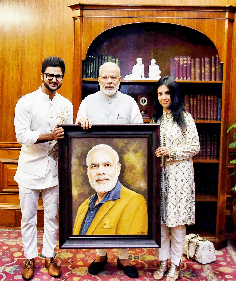 Artist Suvigya Sharma, PM Narendra Modi and Charu Sharma