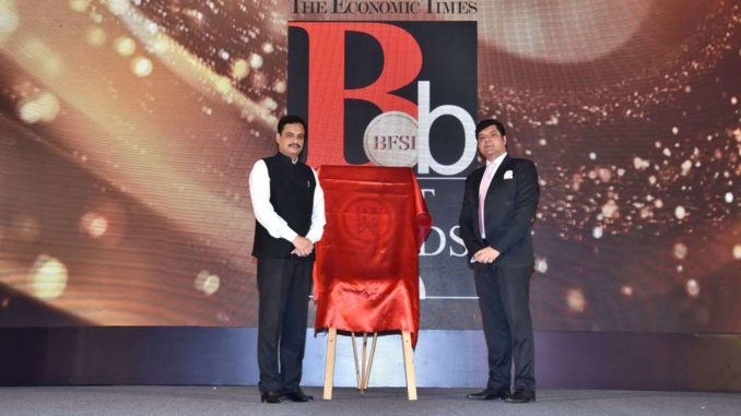 Dr. Ranjit Patil, Minister of State Home unveiling the book the Economic times Best BFSI Coffee Table book