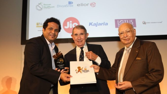Ganesh Somwanshi receiving the Transformational leader award (L) Prof Malcom McDonal and Lord Raj Loomba CBE