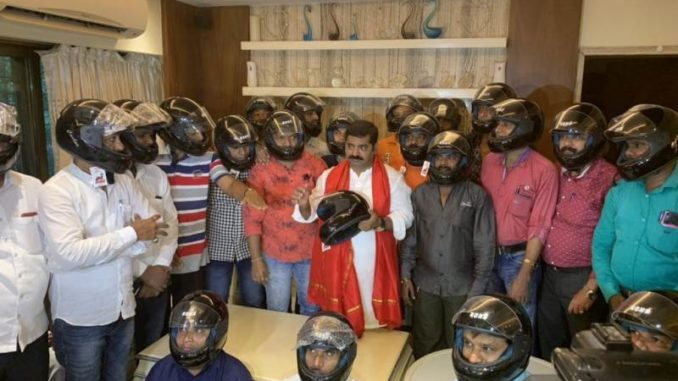 BJP MLA Ram Kadam made a twitter trend by distributing helmets to citizens of Mumbai