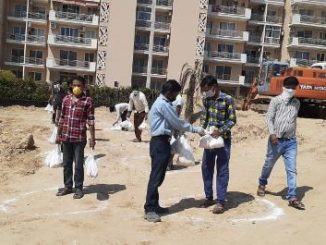 Elan Group distributes one month of ration to over 2000 construction workers
