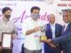 Jayesh Ranjan, KT Rama Rao seen presenting FTCCI Excellence award to Dr A. John Peter