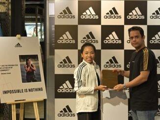 Mirabai Chanu with Mr. Sunil Gupta, Senior Director Brand, adidas India at adidas DLF Promenade Store